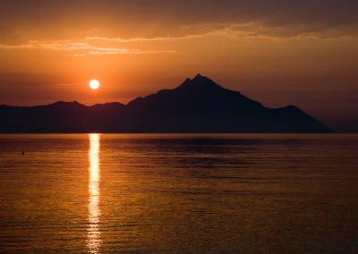 Bright sun in the morning over Mount Athos